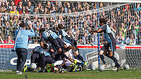 Players pile on top of the stars during The Impractical Jokers (Hit US TV Comedy) filming at Wycombe Wanderers FC at Adams Park, High Wycombe, England on 5 April 2016. Photo by Andy Rowland.