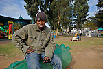 A Sudanese man, who illegally arrived in Israel in search of asylum three years earlier, hangs out at Levinsky Garden, a place that serves as a meeting place and as a pool of cheap workers, in southern Tel Aviv, Israel.