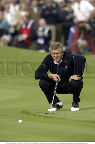 COLIN MONTGOMERIE (EUROPE) lines up a putt on the 5th green during his singles match against Hoch, The 34th Ryder Cup 2002, The Belfry, Sutton Coldfield, 020929. Photo:Glyn Kirk/Action Plus...golf golfer player....