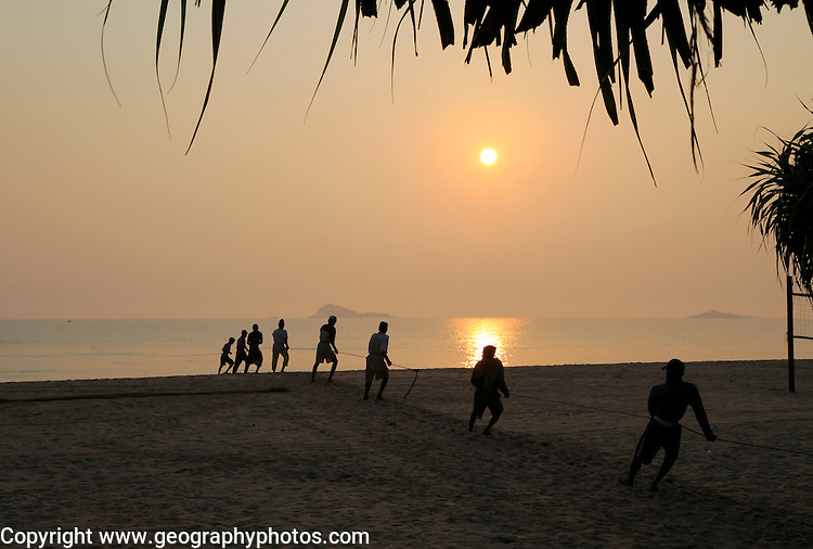 Sunset traditional seine fishing hauling nets Nilavelli beach, near Trincomalee, Eastern province, Sri Lanka, Asia