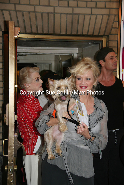 """Christine Ebersole - OLTL and Angela Lansbury in Broadway's Blithe Spirit at Broadway Barks 11 - a """"Pawpular"""" star-studded dog and cat adopt-a-thon on July 11, 2009 in Shubert Alley, New York City, NY. (Photo by Sue Coflin/Max Photos)"""