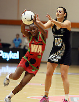 27.10.2013 Silver Fern Joline Henry and Malawi's Bridget Kumwenda in action during the Silver Ferns V Malawi New World Netball Series played at the Pettigrew Green Arena in Napier. Mandatory Photo Credit ©Michael Bradley.