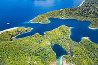 A narrow channel seperates the islands of Gam and Yangeffo, Raja Ampat Islands, West Papua, Indonesia, Pacific Ocean