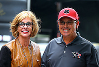 Oct 6, 2013; Mohnton, PA, USA; NHRA top fuel dragster driver Billy Torrence (right) with wife Kay Torrence during the Auto Plus Nationals at Maple Grove Raceway. Mandatory Credit: Mark J. Rebilas-