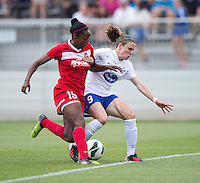 Heather O'Reilly (9) of the Boston Breakers fights for the ball with Robyn Gayle (15) of the Washington Spirit during the game at the Maryland SoccerPlex in Boyds, MD.  Washington tied Boston, 1-1.
