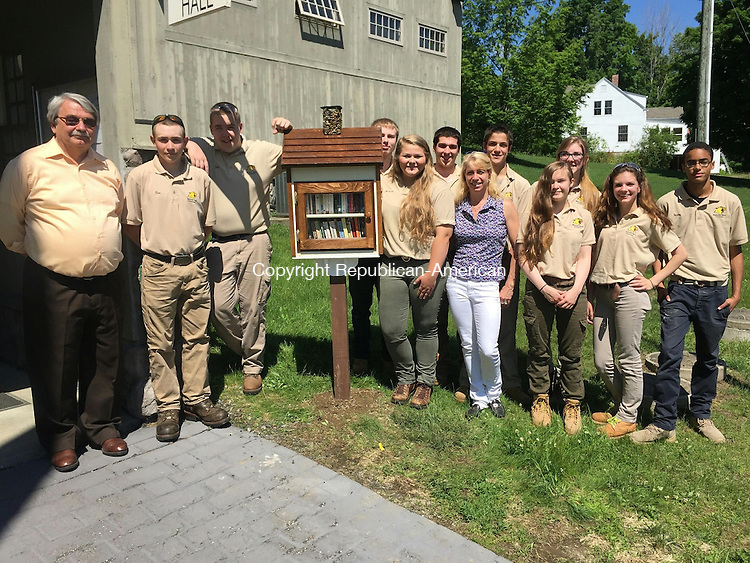 "COLEBROOK, CT- 10 June 2015- 061015HOBJ01-- Oliver Wolcott Technical High School students present the first ""Little Free Library,"" to the  town of Colebrook. The waterproof structures allow residents to take a book and give a book. At the event were Colebrook First Selectman Thomas McKeon, Ben Anderson, Jacob Hitchcock, Adam Devoux, Melissa Johnson, Ray Abeling, Tamara Roper (student council advisor), Brandon Lagasse, Annalise Erwin, Abigail Bigus, Sarah Klotzman and Stalin Gutierrez. Contributed"