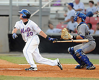 Outfielder Dustin Lawley (20) of the Kingsport Mets, Appalachian League affiliate of the New York Mets, in a game against the Burlington Royals on August 20, 2011, at Hunter Wright Stadium in Kingsport, Tennessee. Kingsport defeated Burlington, 17-14. (Tom Priddy/Four Seam Images)