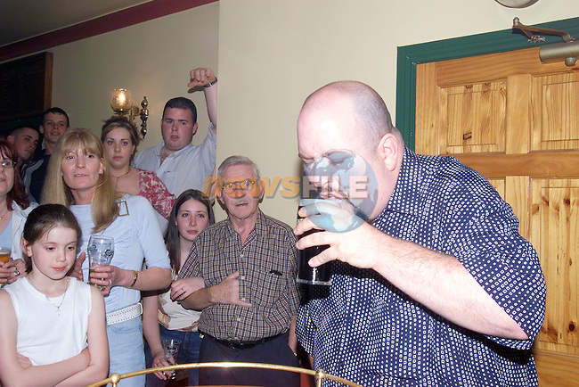 Patrick Carelli who tried to beet the Guinness world Record for drinking the fastest pint of Guinness in the Abbey House in Kells Co Meath..Photo Fran Caffrey/Newsfile.ie..This picture has been sent to you by:.Newsfile Ltd,.3 The View,.Millmount Abbey,.Drogheda,.Co Meath..Ireland..Tel: +353-41-9871240.Fax: +353-41-9871260.GSM: +353-86-2500958.ISDN: +353-41-9871010.IP: 193.120.102.198.www.newsfile.ie..email: pictures@newsfile.ie..This picture has been sent by Fran Caffrey.francaffrey@newsfile.ie