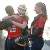 Jessica Budrewicz #9 MacArthur pitcher, center, and sister #4 Ashley Budrewicz, right, celebrate with #8 Shannon Myles after their 5-2 win over Oceanside in a Nassau County varsity softball game at Oceanside High School on Thursday, Mar. 31, 2016. MacArthur overcame a one-run deficit in the top of the seventh inning by plating four runs for the victory.