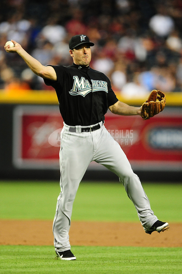 May 31, 2011; Phoenix, AZ, USA; Florida Marlins third baseman Gregg Dobbs throws to first base for the out against the Arizona Diamondbacks at Chase Field. Mandatory Credit: Mark J. Rebilas-