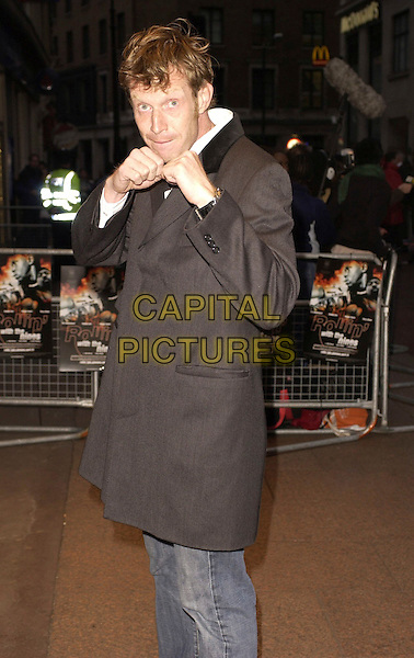 "JASON FLEMYNG.""Rollin' With The Nines"" - UK premiere at the Odeon Leicester Square, London, UK..April 19th, 2006.Ref: CAN.half length hands fists gesture grey gray jacket.www.capitalpictures.com.sales@capitalpictures.com.©Capital Pictures"