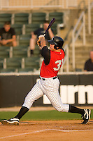 Dan Black #31 of the Kannapolis Intimidators follows through on his swing versus the Lakewood BlueClaws at Fieldcrest Cannon Stadium July 10, 2009 in Kannapolis, North Carolina. (Photo by Brian Westerholt / Four Seam Images)