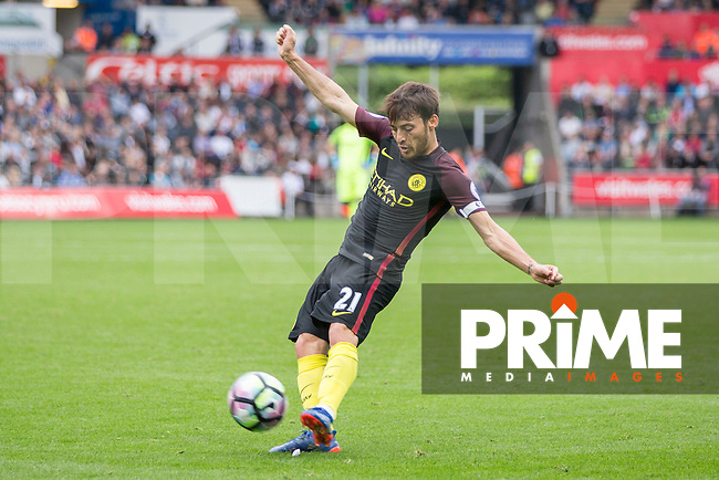 David Silva of Manchester City crosses the ball during the EPL - Premier League match between Swansea City and Manchester City at the Liberty Stadium, Swansea, Wales on 24 September 2016. Photo by Mark  Hawkins.