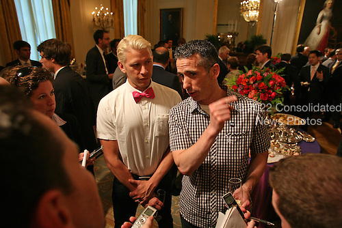 Dan Savage (right), writer of the column, Savage Love, is joined by his husband, Terry Miller, as they chat with reporters at a White House East Room reception honoring Lesbian, Gay, Bi-Sexual, and Transgendered Pride Month in Washington, Wednesday, June 29, 2011..Credit: Martin Simon / Pool via CNP