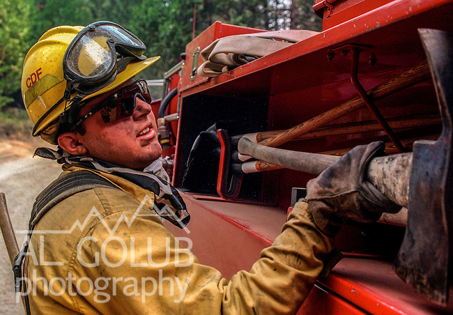 August 26, 1999 Buck Meadows, California -- Pilot Fire – CDF firefighter gets tools from fire truck. The Pilot Fire burned 3,300 acres in the Tuolumne River Canyon near Yosemite National Park. The fire burned across the Hetch Hetchy power lines.