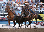 John Franzen competes in the steer wrestling event at the Reno Rodeo in Reno, Nev., on Thursday, June 27, 2013.<br /> Photo by Cathleen Allison