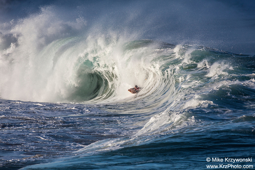 Body boarder riding a big hollow wave at Waimea Shorebreak, North Shore, Oahu, Hawaii