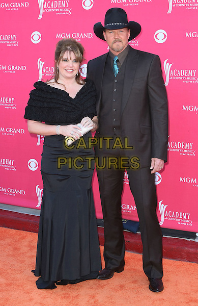 RHONDA & TRACE ATKINS.The 43rd Annual Academy of Country Music Awards (ACM) held at MGM Grand Garden Arena, Las Vegas, Nevada, USA..May 18th, 2008.full length black off the shoulder dress brown suit hat married husband wife .CAP/ADM/MJT.© MJT/AdMedia/Capital Pictures.