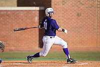 Josh Spano (21) of the High Point Panthers follows through on his swing against the UNCG Spartans at Willard Stadium on February 14, 2015 in High Point, North Carolina.  The Panthers defeated the Spartans 12-2.  (Brian Westerholt/Four Seam Images)