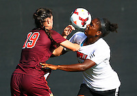 WINSTON-SALEM, NORTH CAROLINA - August 30, 2013:<br /> Christine Exeter (22)  of Louisville University battles for the ball against Jordan Coburn (19) of Virginia Tech during a match at the Wake Forest Invitational tournament at Wake Forest University on August 30. The game ended in a 1-1 tie.