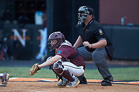 Kannapolis Post 115 catcher Austin Dayvault (11) on defense as the home plate umpire looks on during an American Legion baseball game against Mooresville Post 66 at Northwest Cabarrus High School on May 30, 2019 in Concord, North Carolina. Mooresville Post 66 defeated Kannapolis Post 115 4-3. (Brian Westerholt/Four Seam Images)