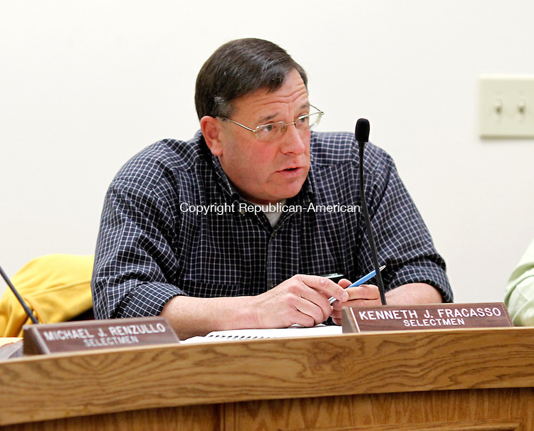 Winsted, CT-26 March 2012-032612CM11-  Winsted Selectman, Kenneth J. Fracasso asks a question during a town meeting Monday night at the Winsted Town Hall.   Members of the public were given the opportunity to voice their concerns for the town's 2012-2013 budget, which will include an 11.3 tax increase.  Christopher Massa Republican-American