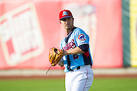 Tennessee Smokies starting pitcher Corey Black (2) warms up in the outfield prior to the game against the Mississippi Braves at Smokies Park on July 22, 2014 in Kodak, Tennessee.  The Smokies defeated the Braves 8-7 in 10 innings. (Brian Westerholt/Four Seam Images)