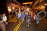 Sutter Creek's annual Parade of Lights Christmas parade downtown on a rainy night in the  Mother Lode of Calif.--Boy Scounts celebrate their 100th anniversary