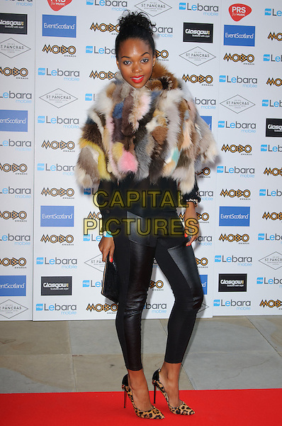 Jessye Romeo.Mobo Nominations at St Pancras International Hotel, London, England .August 31st, 2011.full length black leather trousers leopard print shoes clutch bag fur wrap shawl brown.CAP/CJ.©Chris Joseph/Capital Pictures.