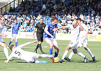 Michael Bolochoweckyj (5) and Iain Campbell (18) combine to stop Ian McGrath in the SPFL Ladbrokes Championship Play Off semi final match between Queen of the South and Montrose at Palmerston Park, Dumfries on  11.5.19.