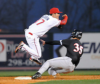 April 3, 2008: John Curtis (35) of the Kannapolis Intimidators runs into Kristopher Negron (17) of the Greenville Drive, breaking up a double play during the season opener for both teams at Fluor Field at the West End in Greenville, S.C. Photo by:  Tom Priddy/Four Seam Images