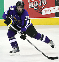 Minnesota State University-Mankato's Eli Zuck looks to pass the puck. (Photo by Michelle Bishop)