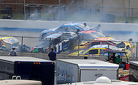 Jun 1, 2008; Dover, DE, USA; The car of NASCAR Sprint Cup Series driver Denny Hamlin (11) is lifted off the ground by Kevin Harvick (29) during a multiple car incident in the Best Buy 400 at the Dover International Speedway. Mandatory Credit: Mark J. Rebilas-US PRESSWIRE