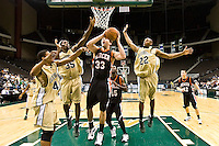 January 9, 2009:     Mercer forward Daniel Emerson (33) goes up for a shot while be guarded by Jacksonville's Lehmon Colbert (41), Jacksonville's Will Alston (35) and Jacksonville's Aric Brooks (22) in Atlantic Sun Conference action between the Jacksonville Dolphins and the Mercer Bears at Veterans Memorial Arena in Jacksonville, Florida.  Jacksonville defeated Mercer 80-59.