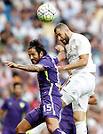 Real Madrid's Karim Benzema (r) and Malaga's Marcos Alberto Angeleri during La Liga match. September 26,2015. (ALTERPHOTOS/Acero)