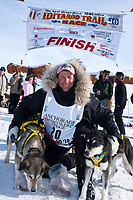 Second-place finisher Hans Gatt poses with his lead dogs at the Nome finish line during the 2010 Iditarod