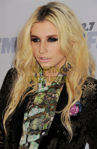 Ke$ha, Kesha Rose Sebert.The KIIS FM's Jingle Ball 2012 held at Nokia Theatre L.A. Live in Los Angeles, California, USA..December 3rd, 2012.headshot portrait black green scarf print smokey eyes make-up hair roots beauty .CAP/ROT/TM.©Tony Michaels/Roth Stock/Capital Pictures