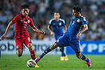 (R) Leonel Vangioni  of Argentina competes for the ball with (L) Deshuai Xu of Hong Kong during the HKFA Centennial Celebration Match between Hong Kong vs Argentina at the Hong Kong Stadium on 14th October 2014 in Hong Kong, China. Photo by Aitor Alcalde / Power Sport Images