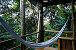 A hammock in an open air room overlooking Bahia Honda and the jungle at an eco-lodge in Bastimentos, Bocas del Toro, Panama