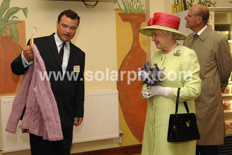 **ALL ROUND PICTURES FROM SOLARPIX.COM**.**SYNDICATION RIGHTS FOR SPAIN, PORTUGAL & DUBAI (U.A.E) ONLY**.The Queen and The Duke of edinburgh in the heavy rain touring  The Yeo Valley food plant at Yatton in Summerset they also visited  knightston to see the reconstruction of the sea front..JOB REF:4357   NLA    DATE: 20.07.07.*UNDER NO CIRCUMSTANCES IS THIS IMAGE TO BE REPRODUCED FOR ANY ONLINE EDITION WITHOUT PRIOR PERMISSION*