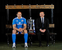 London, England. Italy captain Sergio Parisse and Jacques Brunel the Italy head coach pose with the Six Nations trophy during the RBS Six Nations launch at The Hurlingham Club on January 23, 2013 in London, England.