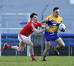 Alan Sweeney of Clare in action against Fergal Donohoe of Louth during their national League game in Cusack Park. Photograph by John Kelly.