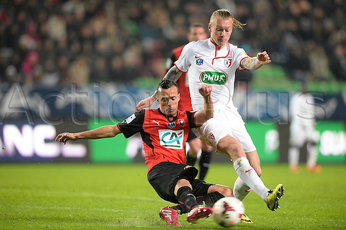 27.03.2014 Rennes, France. Foued Kadir (Rennes) vs Simon KJAER (lille) in action during the Coupe de France quarter final match between Rennes and Lille. Rennes won the match 2-0.