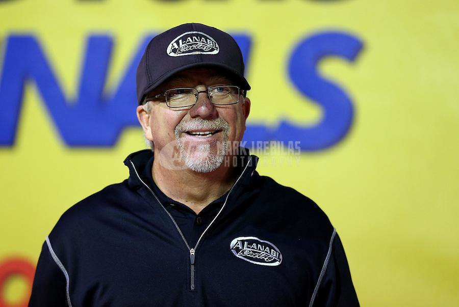 Nov 10, 2013; Pomona, CA, USA; NHRA team owner Alan Johnson celebrates after winning the Auto Club Finals at Auto Club Raceway at Pomona. Mandatory Credit: Mark J. Rebilas-