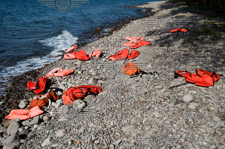 Discarded lifejackets lie on the beach near Skala Sykaminias on Lesbos island in Greece. Every day hundreds of refugees, mainly from Syria and Afghanistan, are crossing in small overcrowded inflatable boats the six mile channel from the Turkish coast to the island of Lesbos in Greece. Many spend their life savings, over $1,000, to buy a space on these boats.