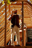 A woodworking re-enactor builds a building with 18th century tools.