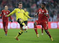 FUSSBALL  DFB-POKAL  VIERTELFINALE  SAISON 2012/2013    FC Bayern Muenchen - Borussia Dortmund          27.02.2013 Mario Goetze (Borussia Dortmund) gegen David Alaba (re, Bayern Muenchen)