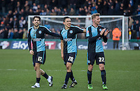Max Kretzschmar (left) of Wycombe Wanderers & Jason McCarthy of Wycombe Wanderers celebrate at the final whistle with goal scorer Luke O'Nien (centre) of Wycombe Wanderers during the Sky Bet League 2 match between Wycombe Wanderers and Bristol Rovers at Adams Park, High Wycombe, England on 27 February 2016. Photo by Kevin Prescod.