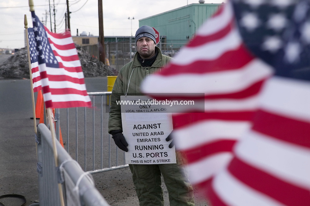 24 February 2006 - Newark, NJ - A member of the Longshoremen's Local 1804-1 union protests outside the Port of Newark Container Terminal in Newark, USA, against the planned transfer of the management of certain US ports to a United Arab Emirates company, 24 February 2006.