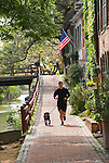 Washington DC; USA: Along the C&O Canal, or Chesapeake and Ohio Canal. Jogger with dog along the canal in Georgetown..Photo copyright Lee Foster Photo # 28-washdc79798